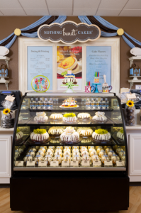Picture of a display case full of bundt cakes, bundtlets and bundtinis